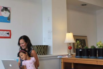 Lillie Lavado, owner of Hardscrabble Solutions in Presque Isle, seen here with her daughter Saraphina, works as a freelance web designer and opened the family-friendly co-working space in May 2017
