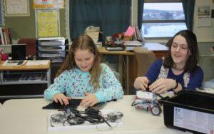 Girls work on LEGO Mindstorm Robotics in Lillie Lavado's KidzCode Robotics Class