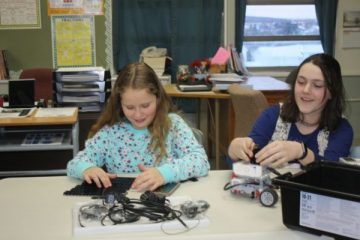 Girls work on LEGO Mindstorm Robotics in Lillie Lavado's KidzCode Robotics Class