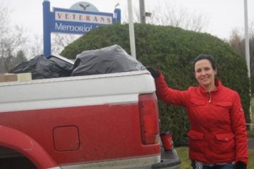 Candidate Lillie Lavado in front of Pickup Truck with Donation for DV survivors and foster children