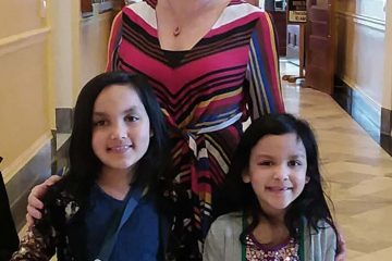 Lillie Lavado with her two children at Maine State House in 2020